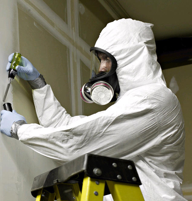 Asbestos being removed by a professional asbestos remover